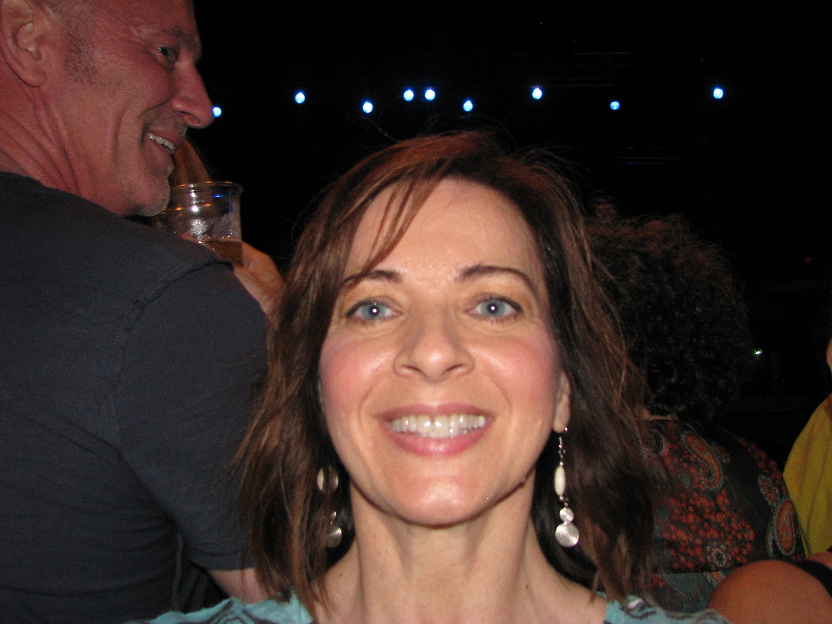 Paula in front of Kansas stage smiling