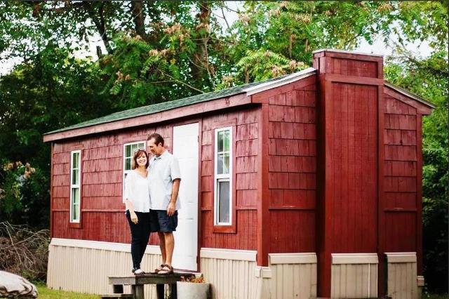 PaulaReyne.com Paula in front of tiny house 640x426