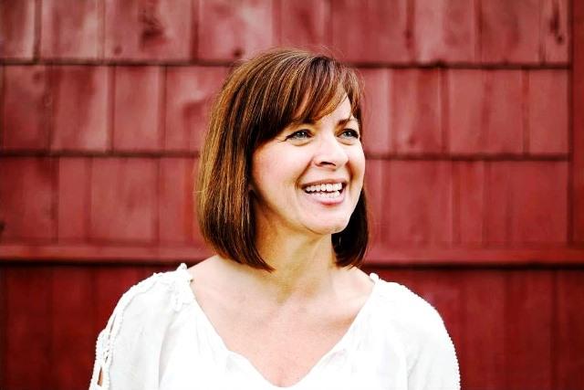 PaulaReyne.com Paula in front of tiny house 640x427