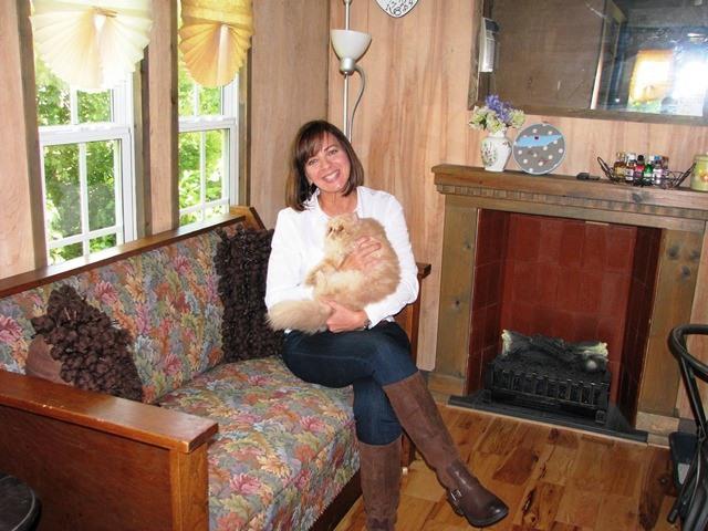 PaulaReyne.com Paula with Latte in LR of tiny house 640x480